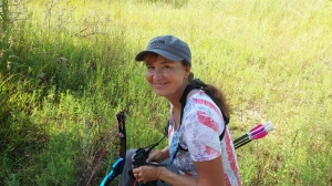 Lana looking happy, she's always smiling and enjoying her archery. This photo of her came out super good.